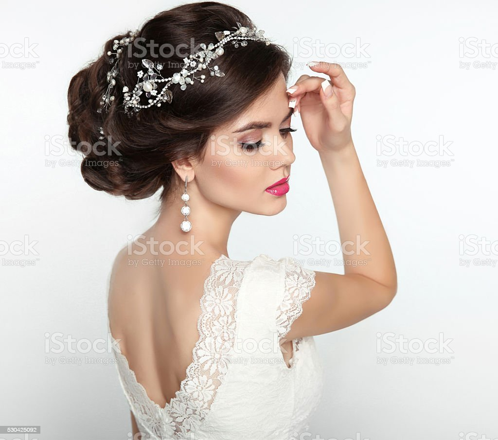 Wedding Hairstyle. Beautiful fashion bride girl model portrait. stock photo