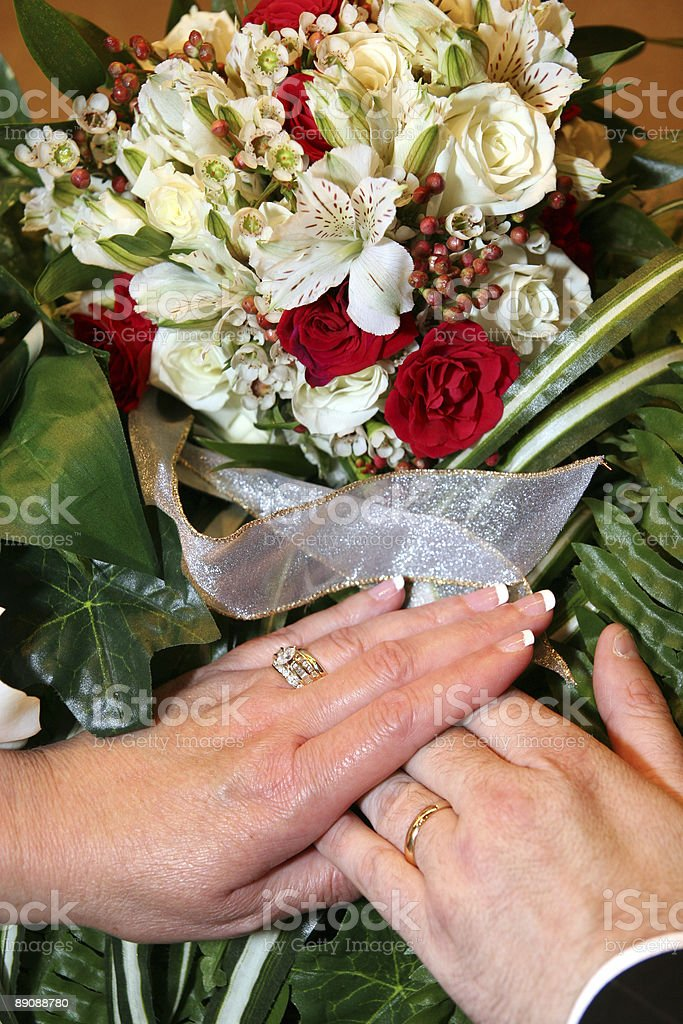 Wedding - Hands, Rings and Flowers royalty-free stock photo