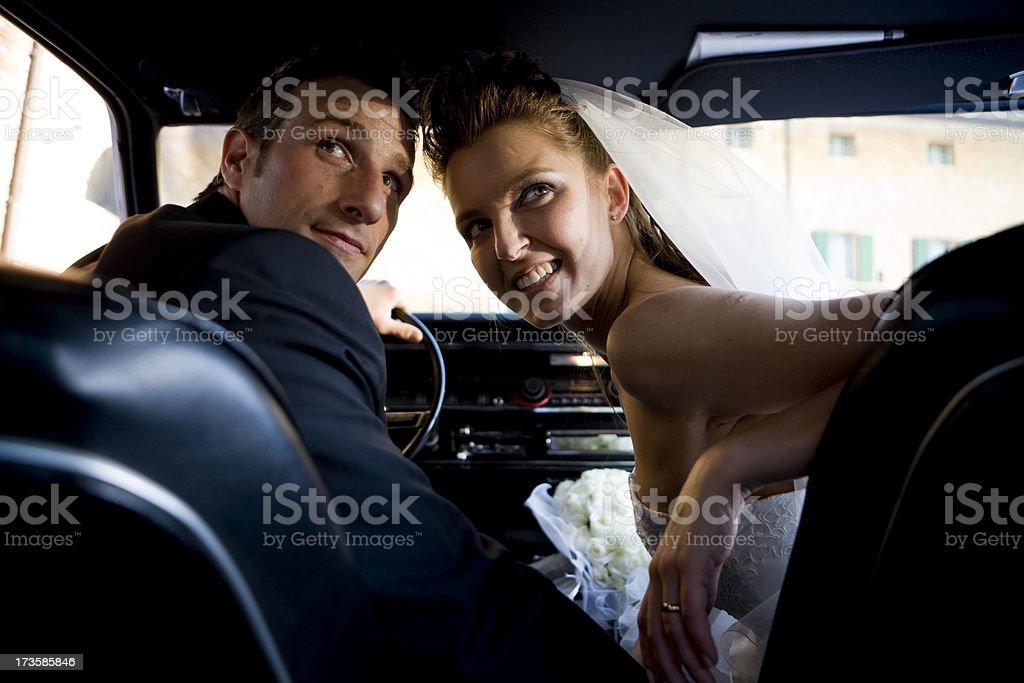 wedding into the car royalty-free stock photo