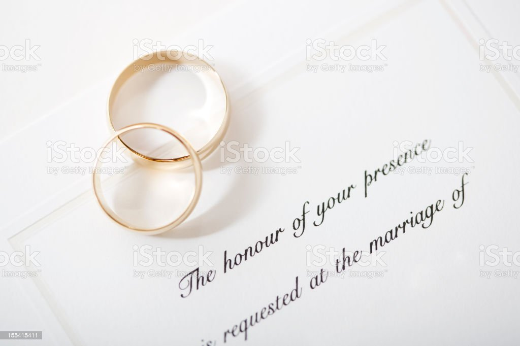Wedding invitation and rings royalty-free stock photo