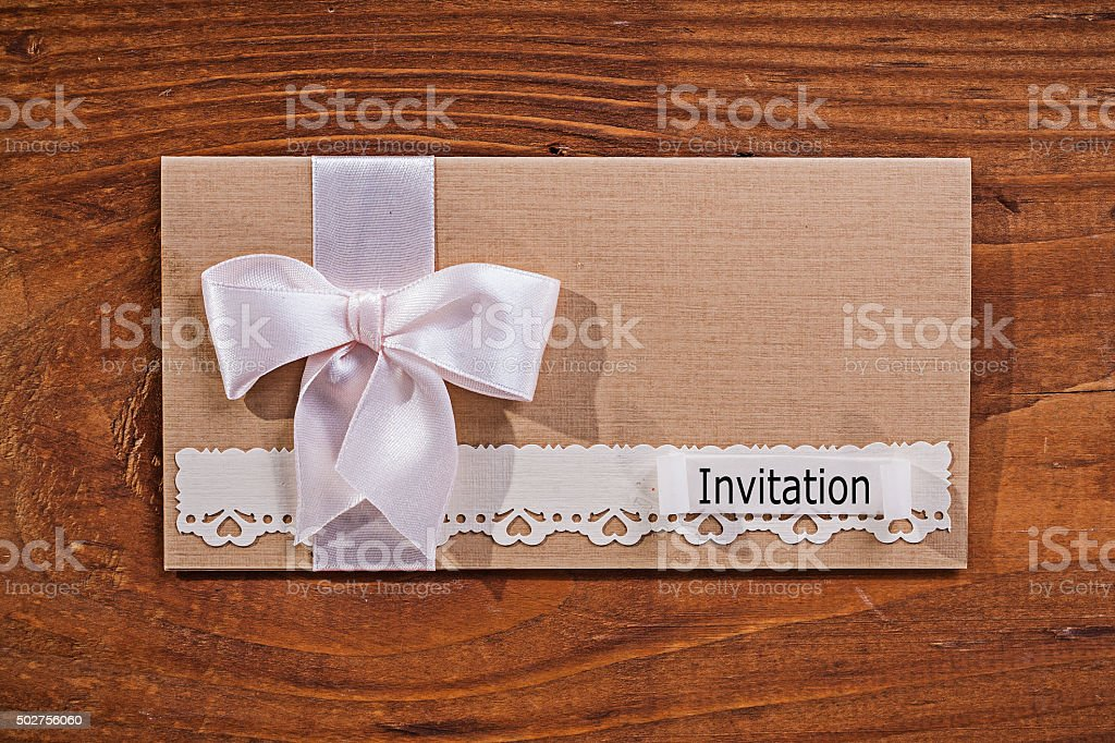 wedding invitation envelope on old wooden board stock photo