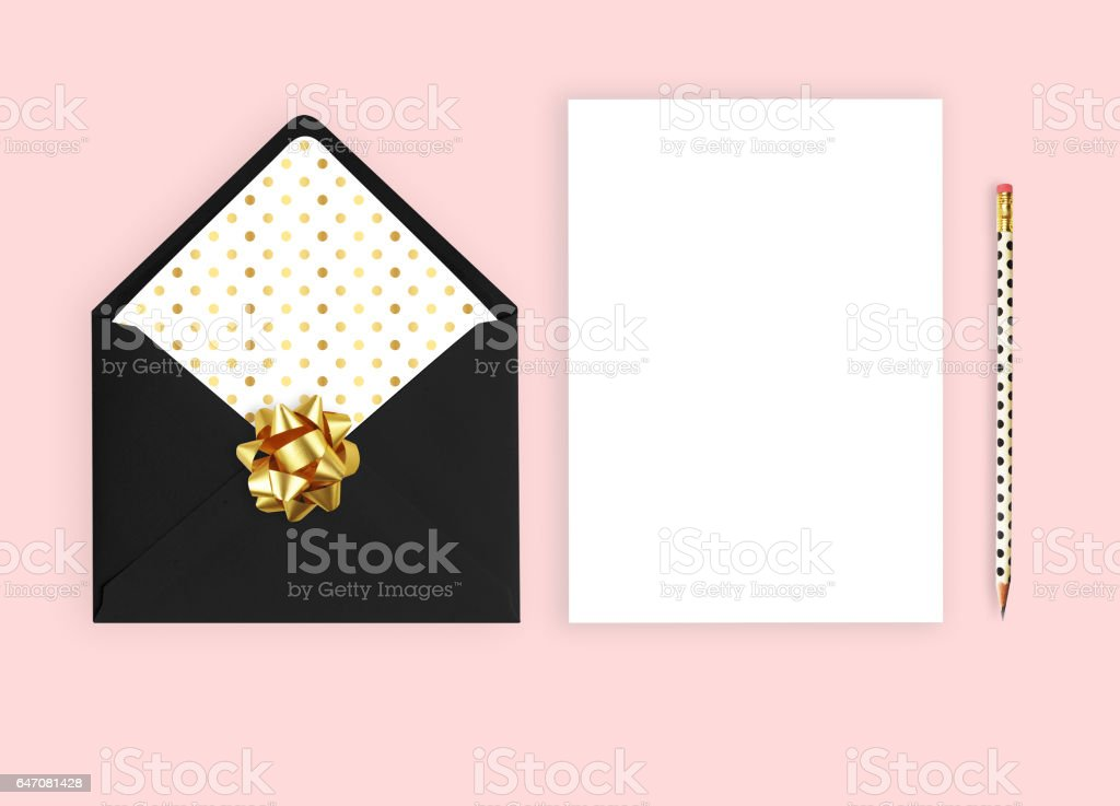 Wedding invitation mockup. Pink background, Flat lay, envelope with card.'nStationery items. stock photo