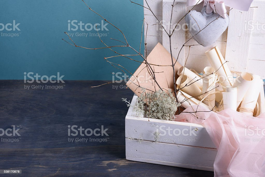 Wedding invitation scrolls in a wooden box stock photo