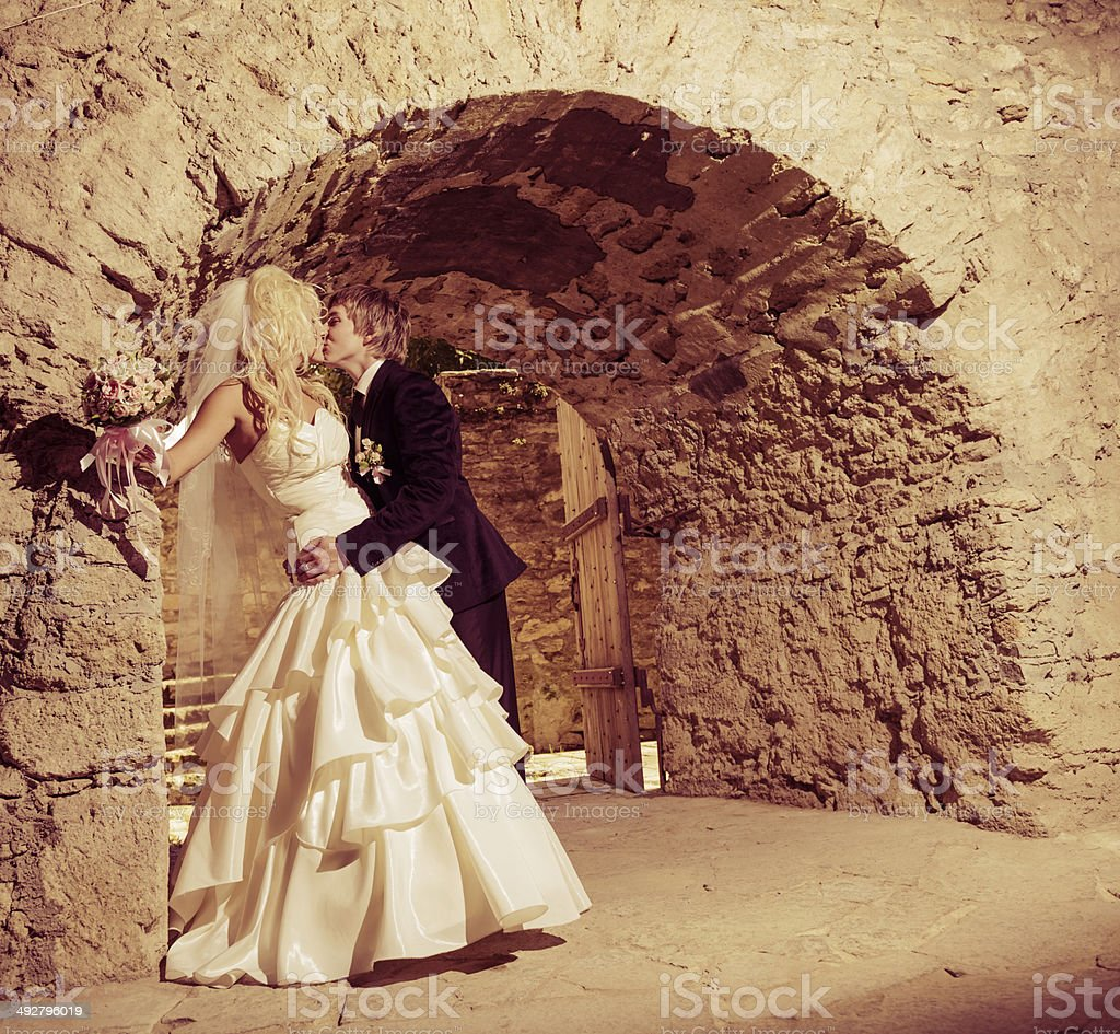 wedding kiss at vintage mansion royalty-free stock photo