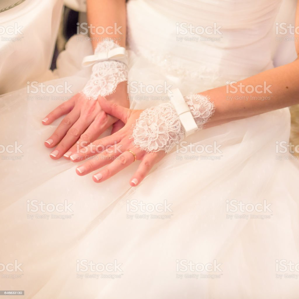 Wedding lace gloves of the bride stock photo