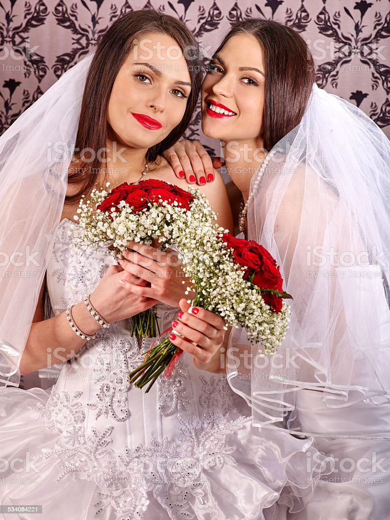 Wedding lesbians girl in bridal dress stock photo