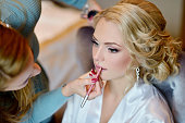 Wedding makeup artist making a make up for bride