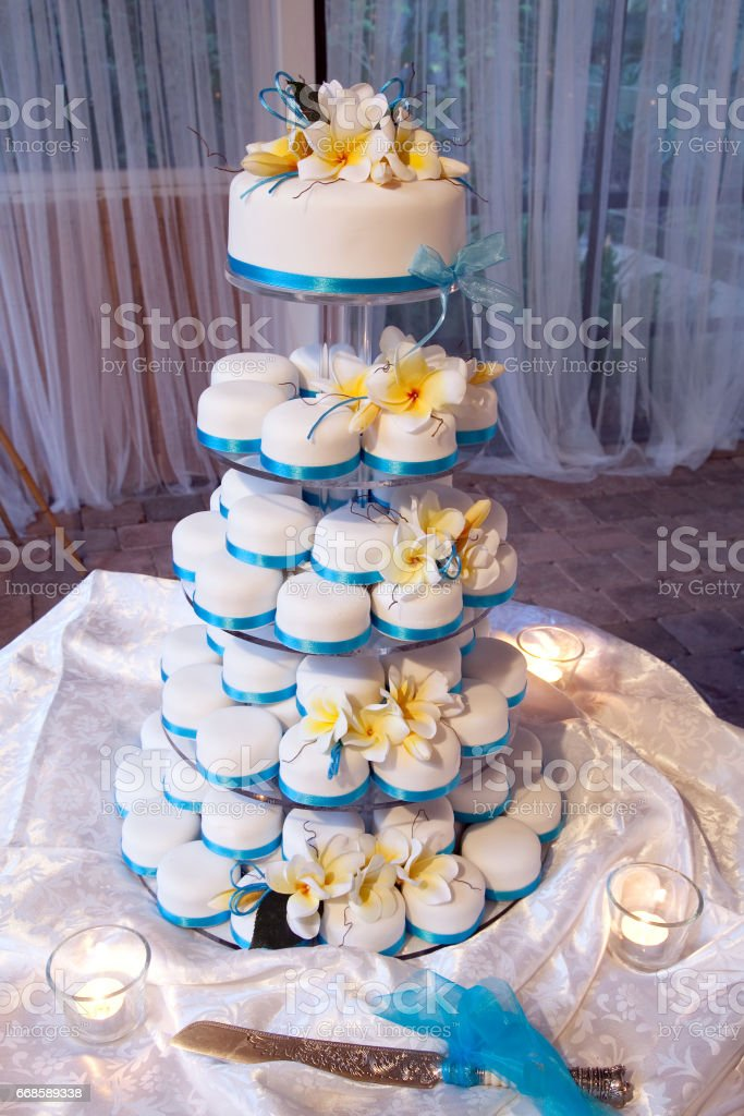 Wedding Mini Cake with Ribbons and Marzipan Flowers stock photo