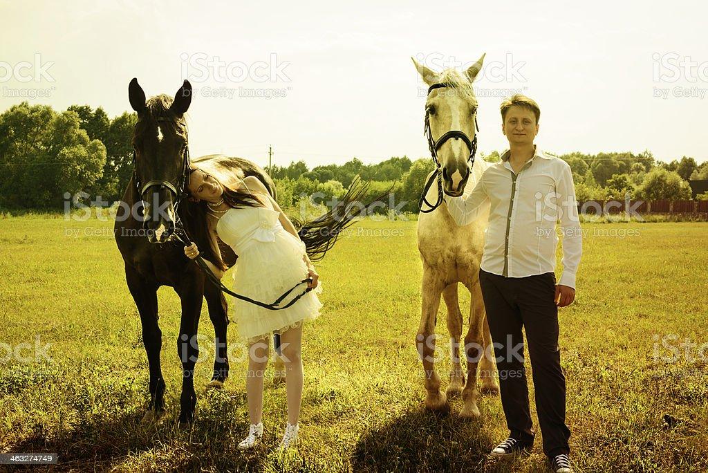 wedding of unusual couple happy near horses royalty-free stock photo