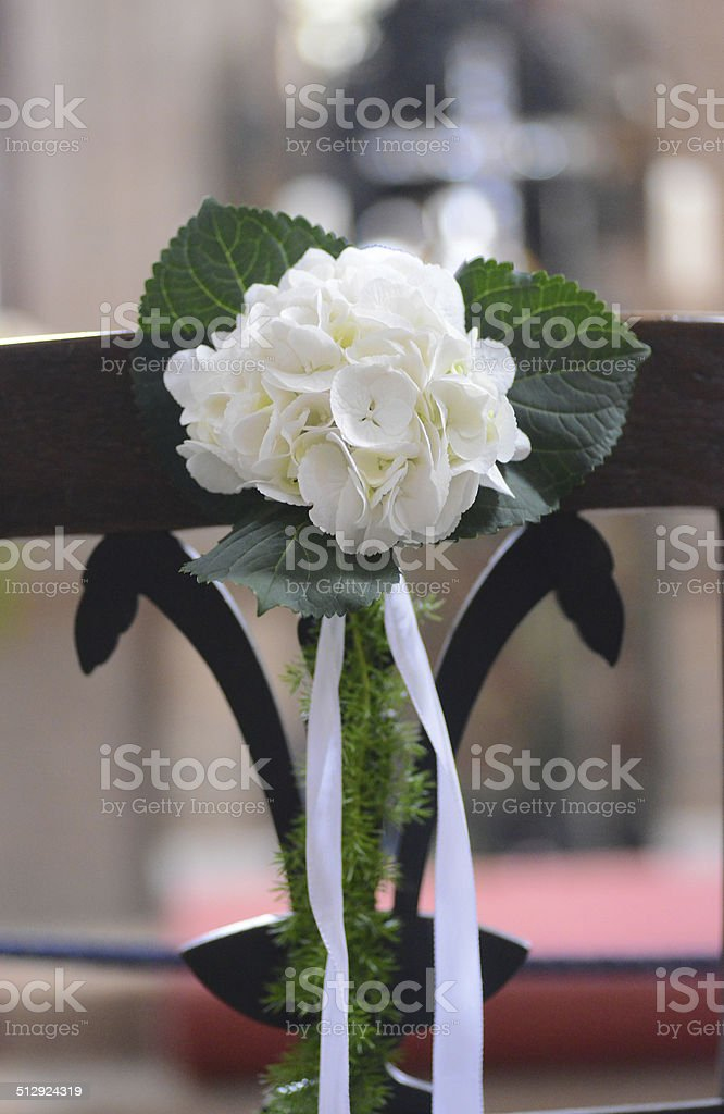 wedding ornament with white flowers in church stock photo
