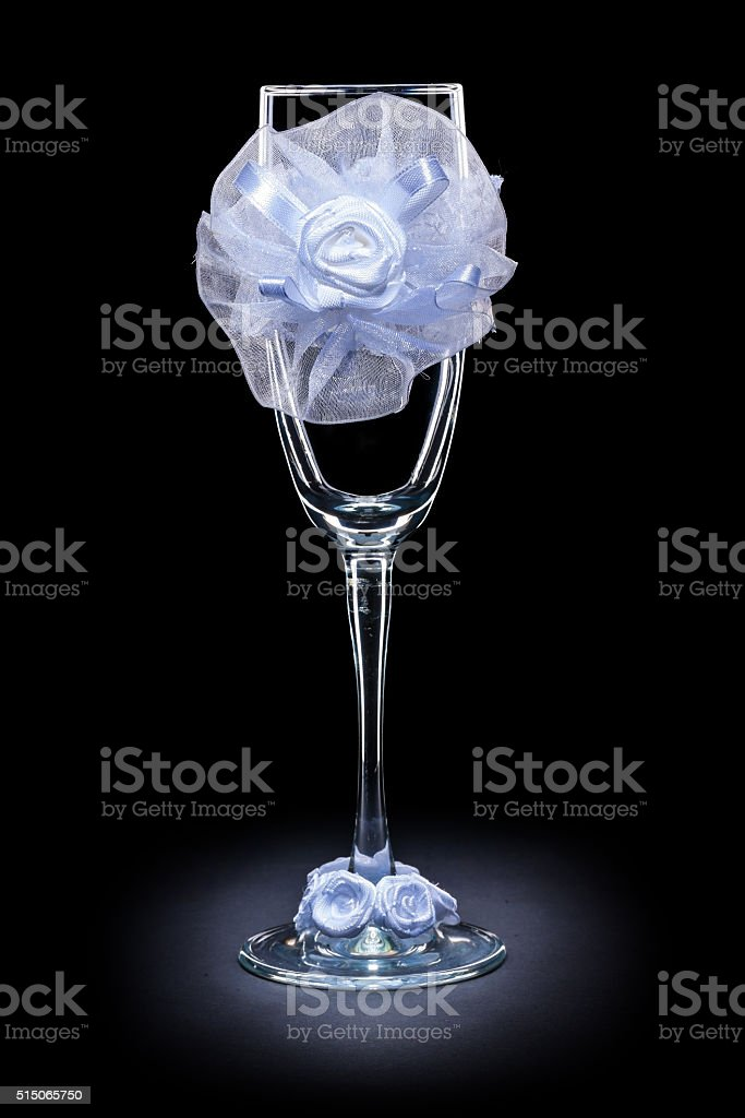 wedding ornated empty wineglass on black background stock photo