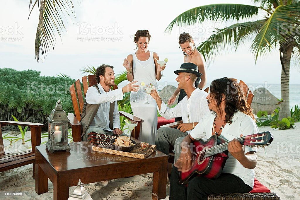 Wedding party and man playing guitar stock photo