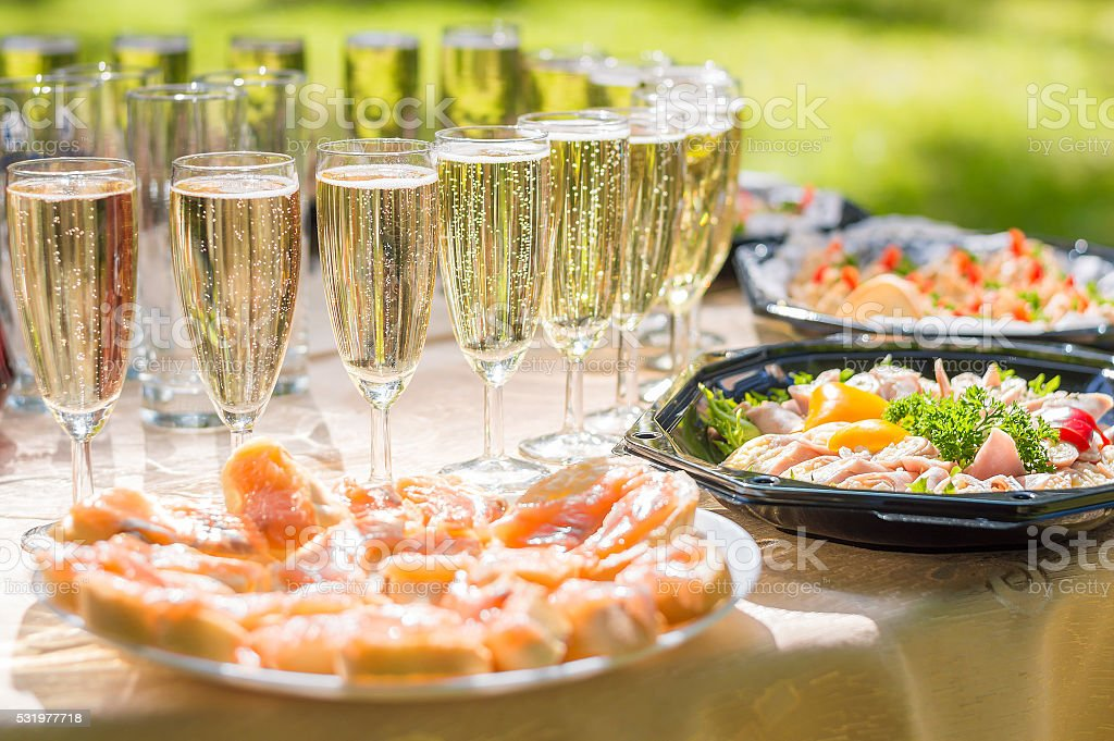Wedding party buffet with champagne, canape, sandwiches stock photo