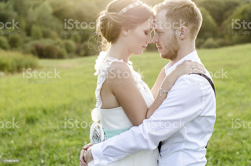 Wedding photo shot of a lovely couple holding each other stock photo