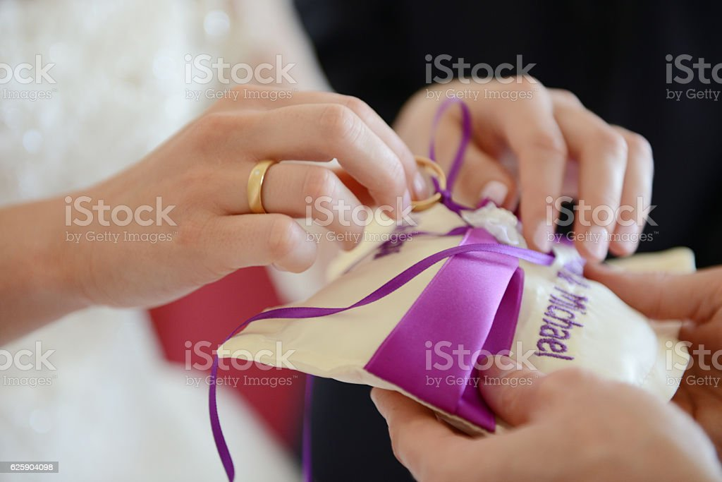 Wedding pillow with rings stock photo