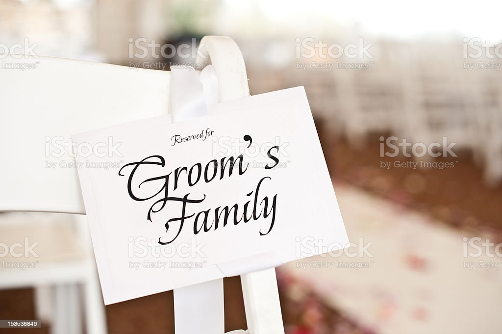 Wedding Place Card Seating Plan on Chair at Ceremony stock photo
