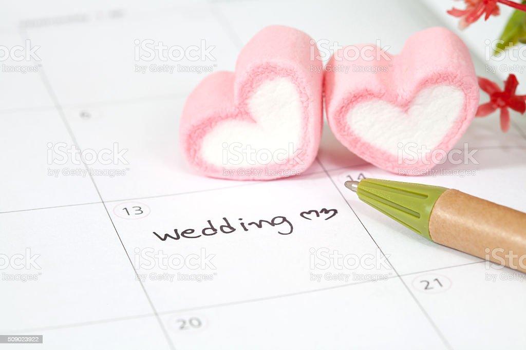 wedding plan on calendar and heart shape stock photo