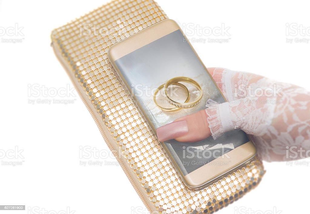 Wedding Planner app on gold phone stock photo