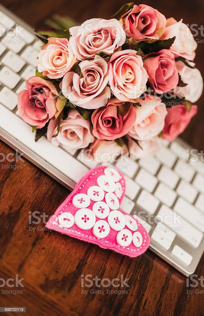 Wedding planning online, wedding bouquet, keyboard and heart. stock photo