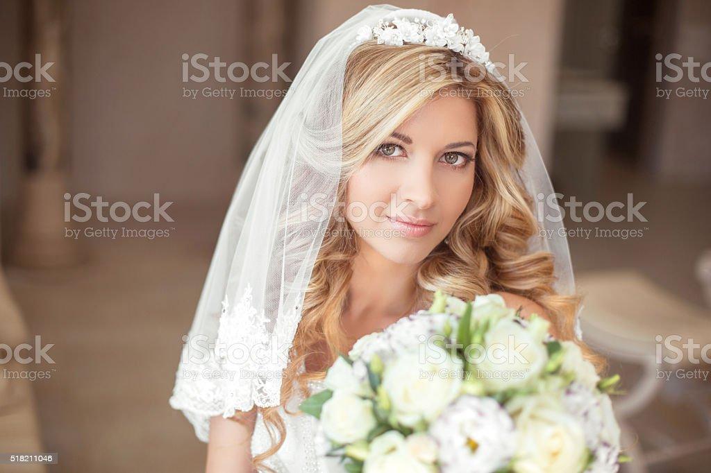Wedding portrait Beautiful bride girl with long wavy hair stock photo