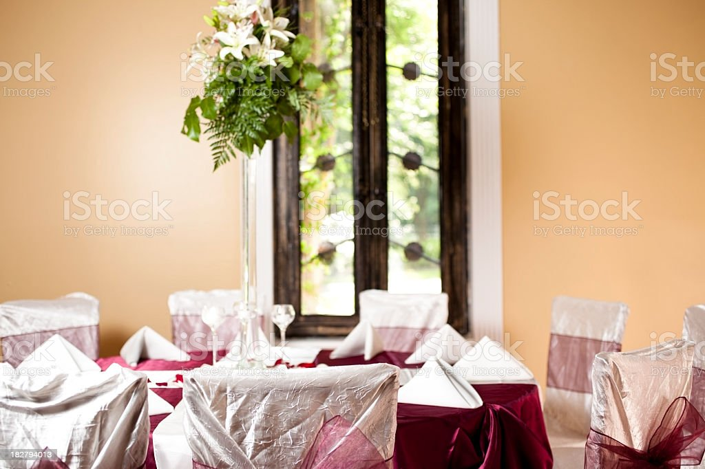 Wedding reception tables with floral centerpieces royalty-free stock photo