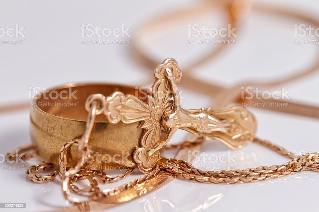 Wedding ring and gold Orthodox cross stock photo