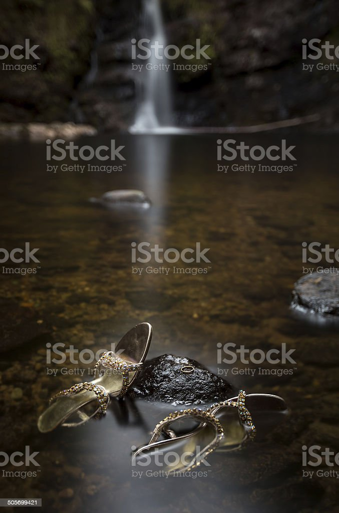 Wedding ring and shoes in river royalty-free stock photo