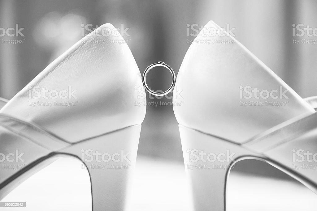Wedding Ring between the bridal shoots stock photo