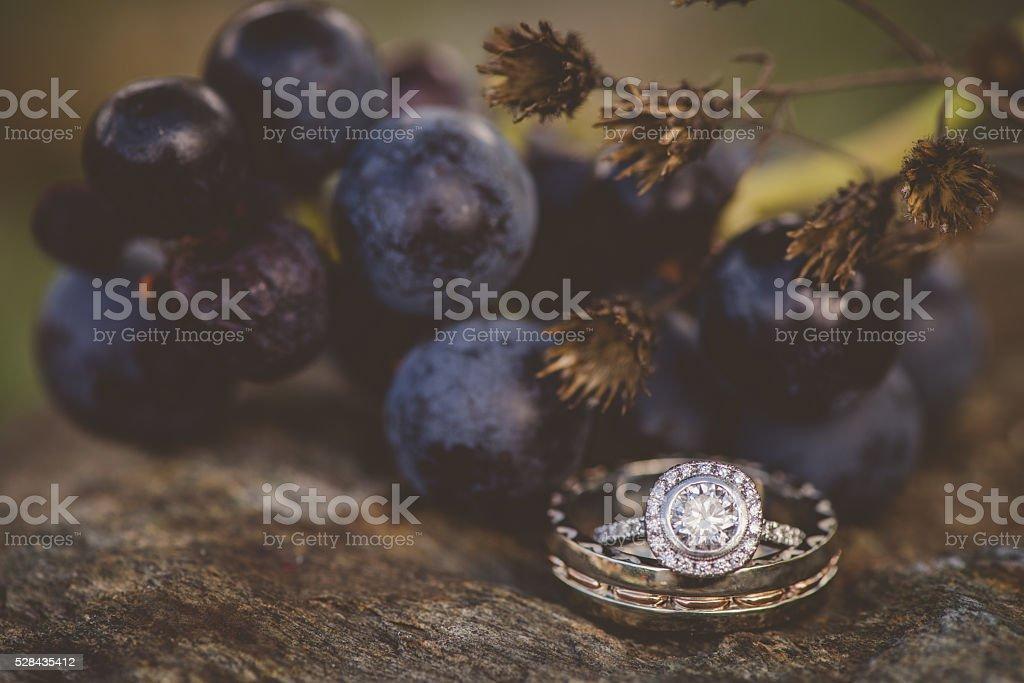 Wedding ring by vineyard grapes stock photo
