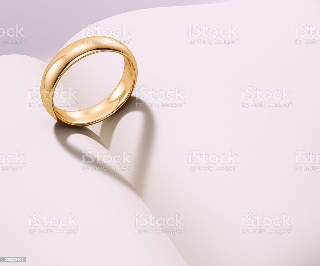 Wedding ring casting heart shaped shadow stock photo