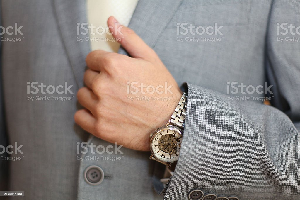 wedding ring on a man's hand stock photo