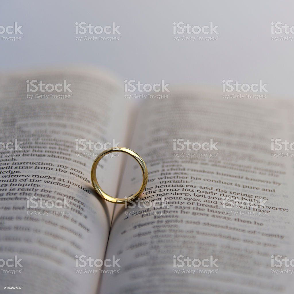 wedding ring on bible stock photo