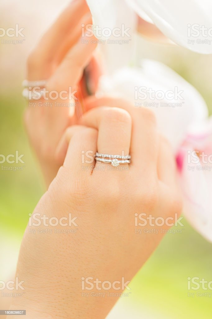 Wedding ring on bride's hand royalty-free stock photo