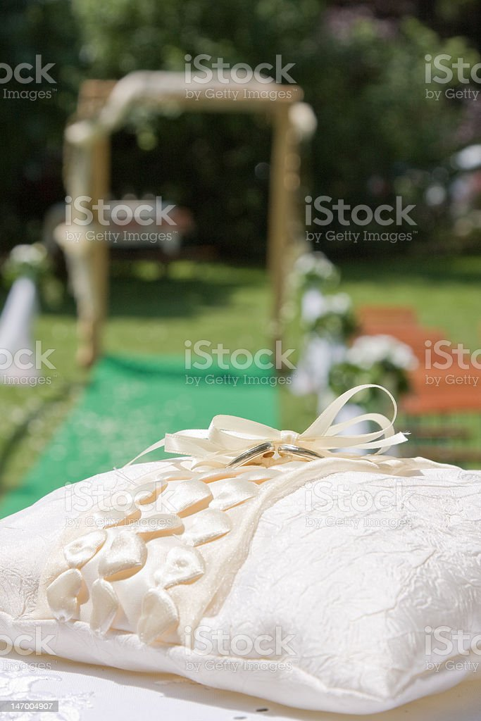 wedding ring on pillow royalty-free stock photo