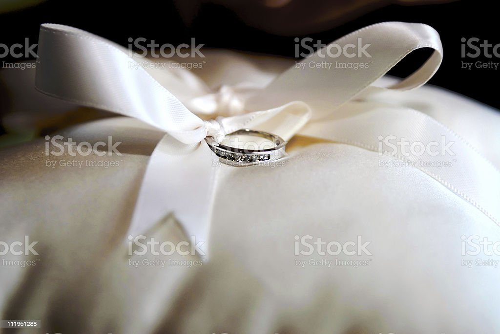 Wedding Ring on Pillow with bow royalty-free stock photo