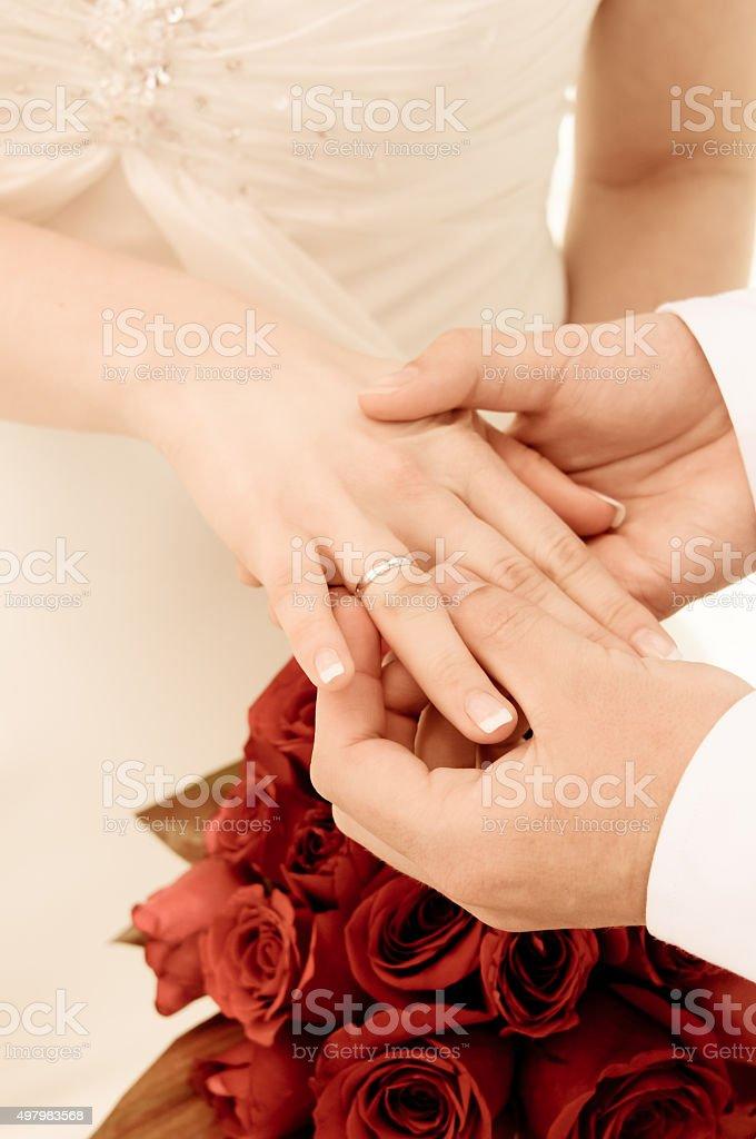 Wedding ring on the finger. stock photo