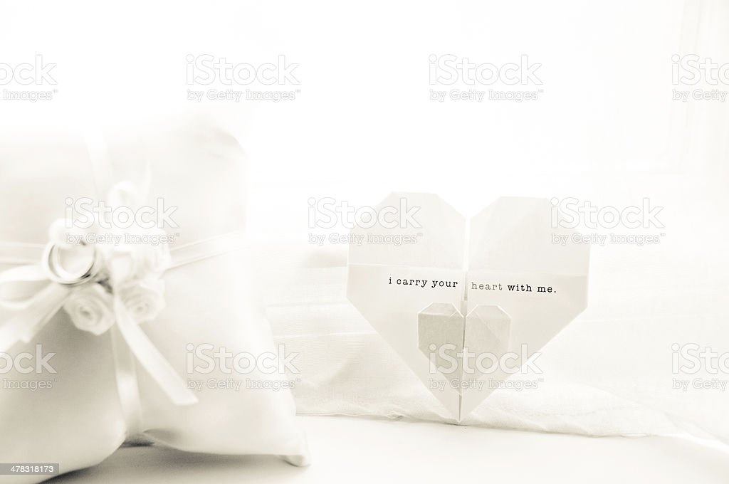 Wedding Ring Pillow and Origami Invitation royalty-free stock photo