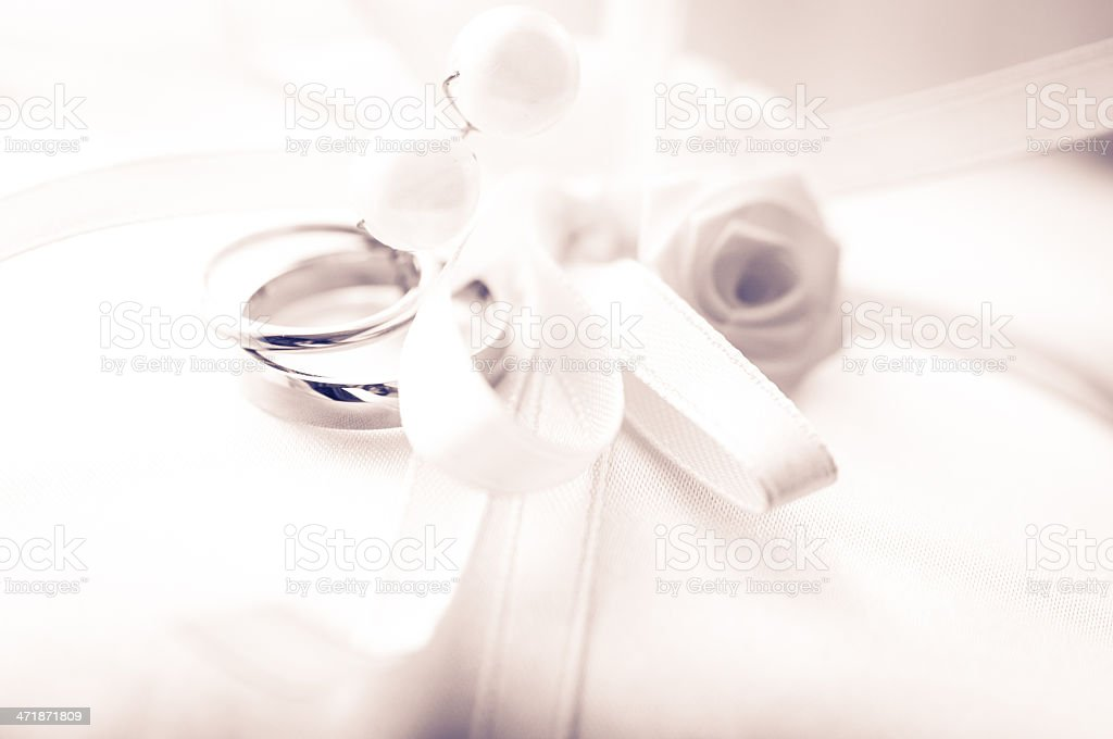 Wedding Ring Pillow, focus on Rose shallow depth of field royalty-free stock photo