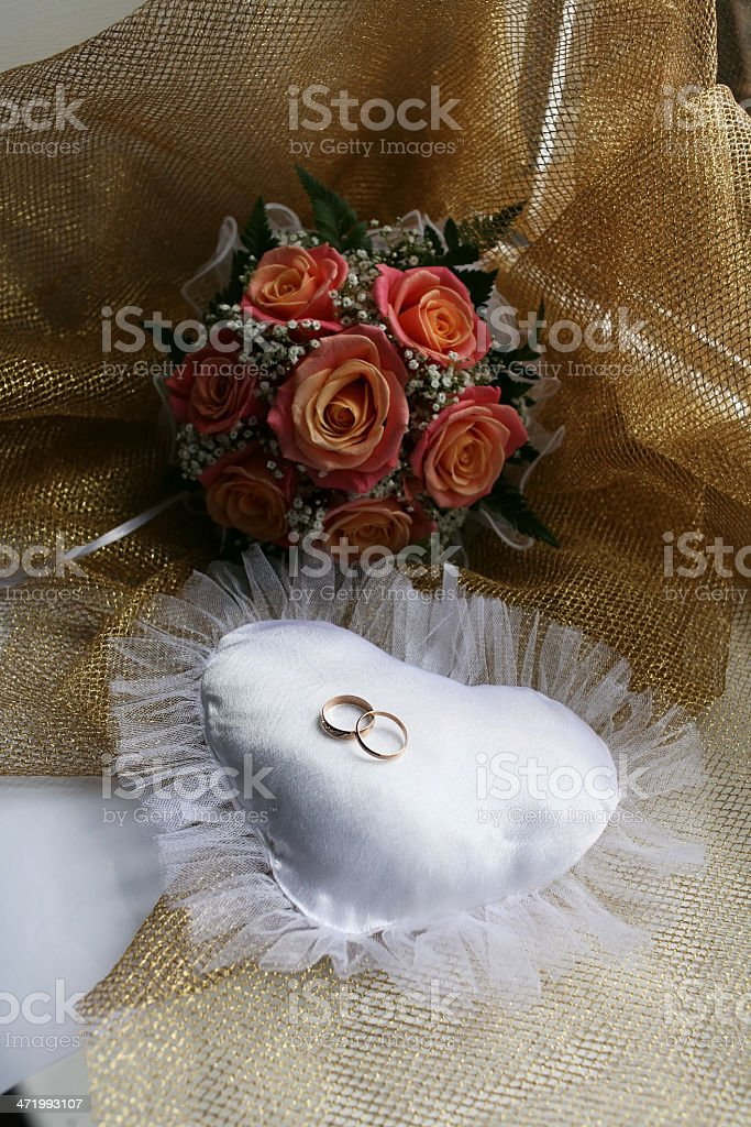 Wedding rings and bouquet royalty-free stock photo