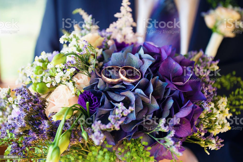 wedding rings and bridal bouquet stock photo