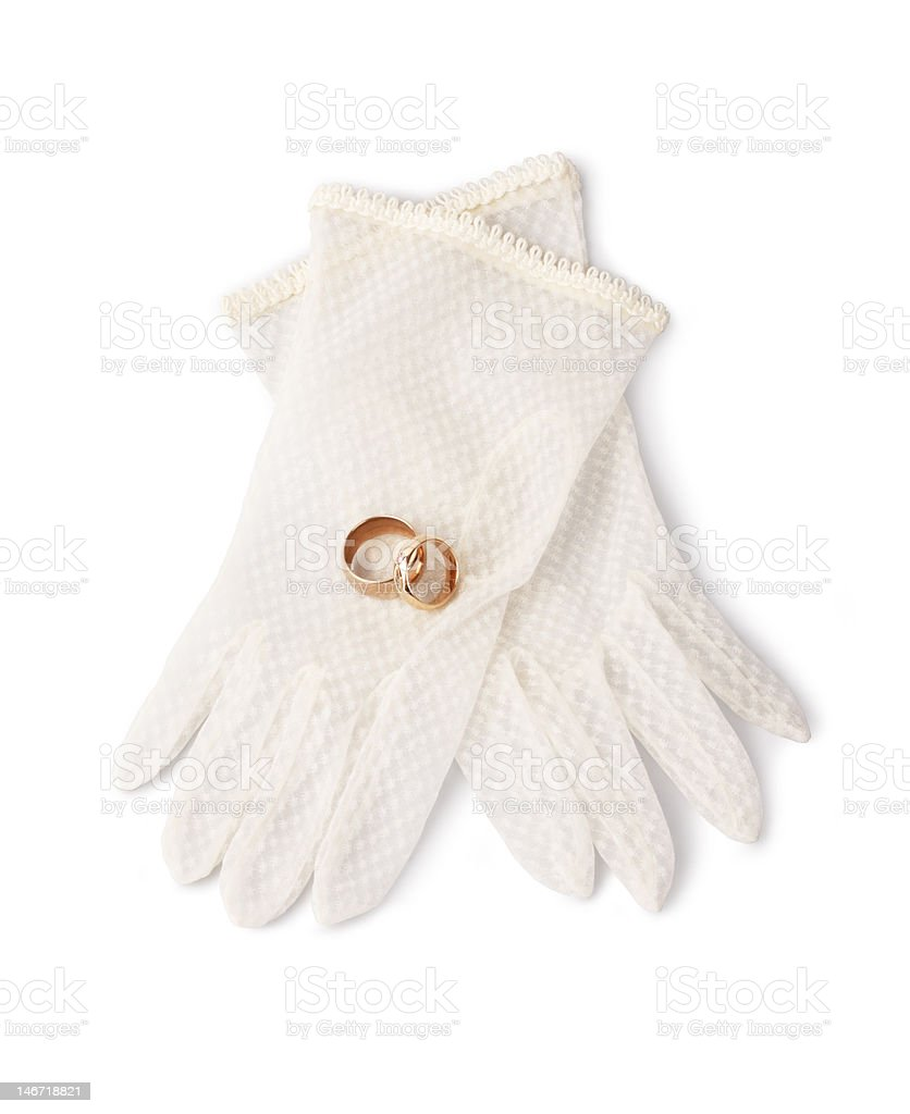 Wedding rings and delicate gloves royalty-free stock photo