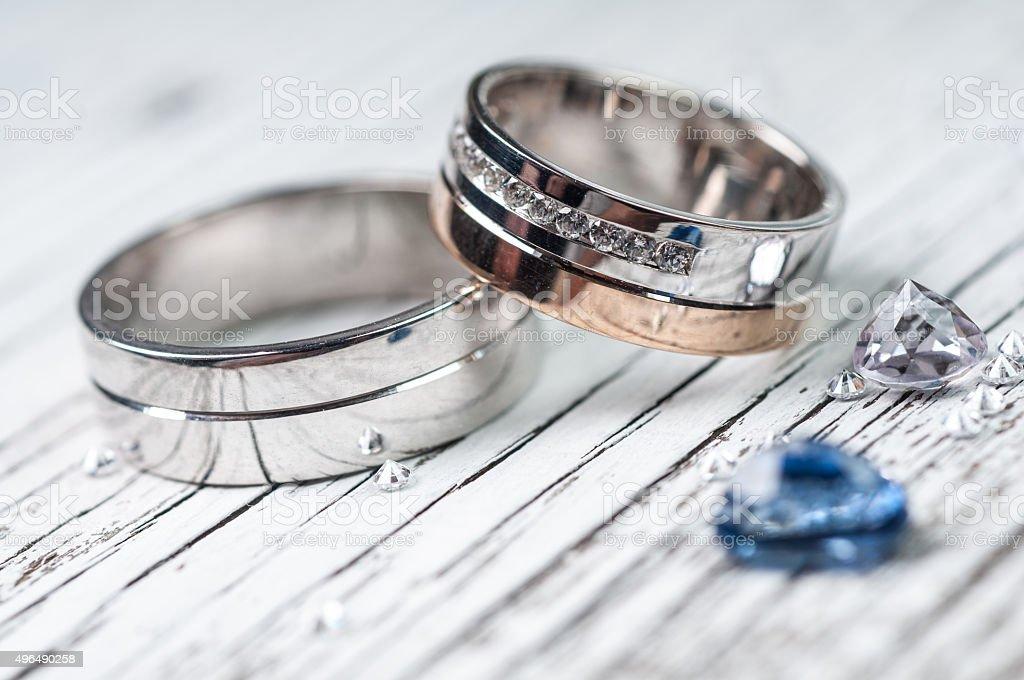 Wedding rings and gemstone stock photo