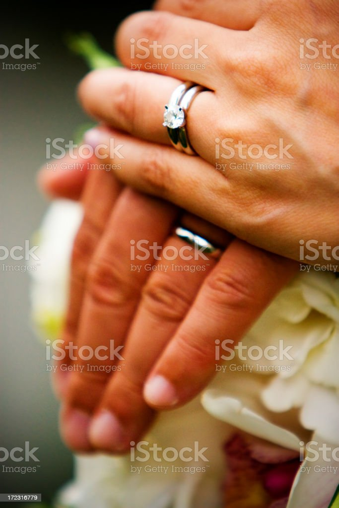 wedding rings and hands stock photo