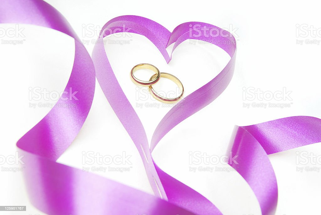 Wedding rings and heart royalty-free stock photo