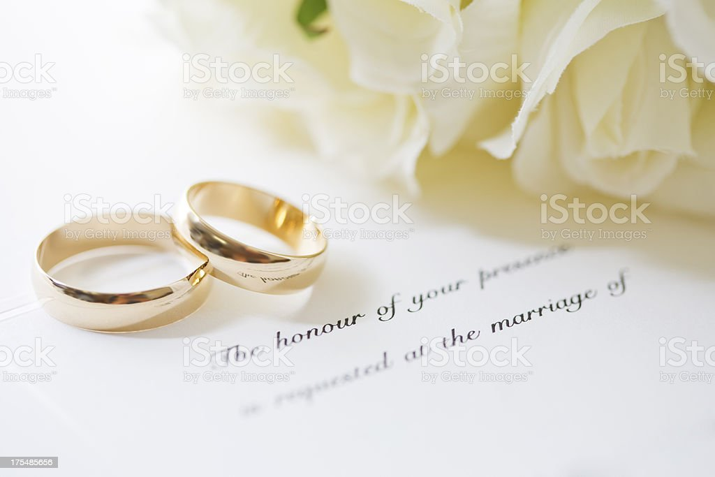 Wedding Rings and Invite stock photo