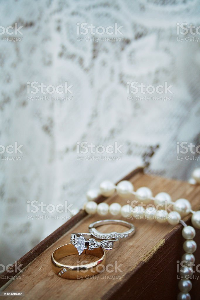 Wedding Rings and Necklace on Book stock photo