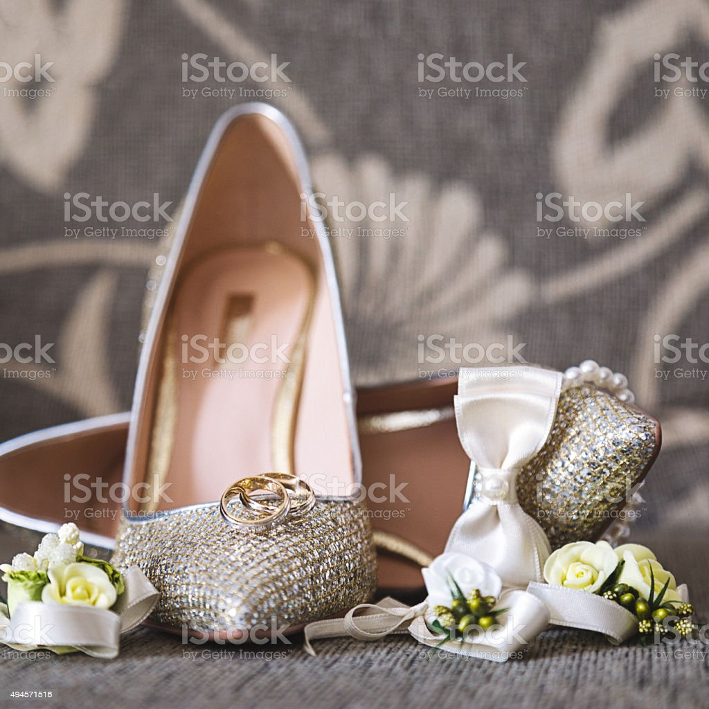 Wedding rings and shoes stock photo