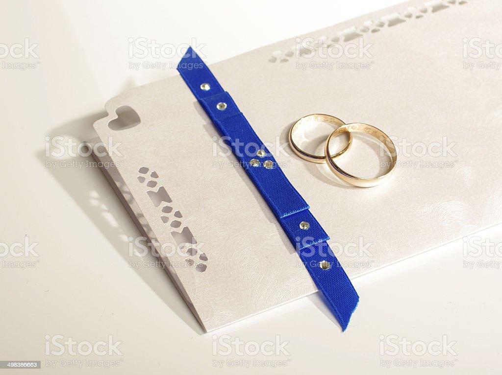Wedding rings and wedding invitation royalty-free stock photo