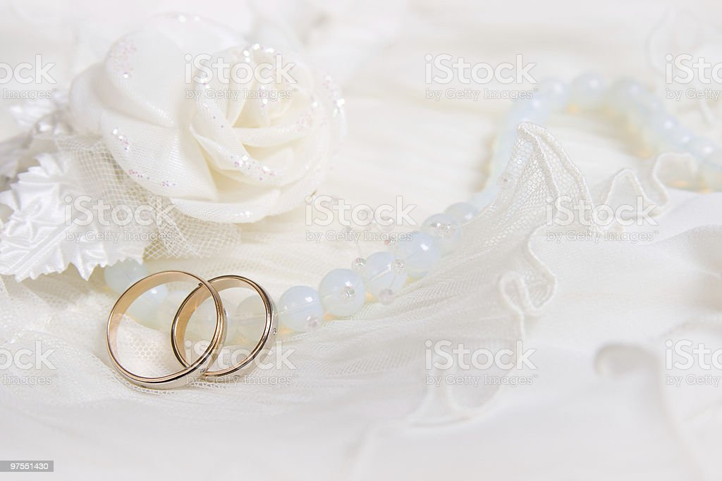 Wedding rings and white rose stock photo