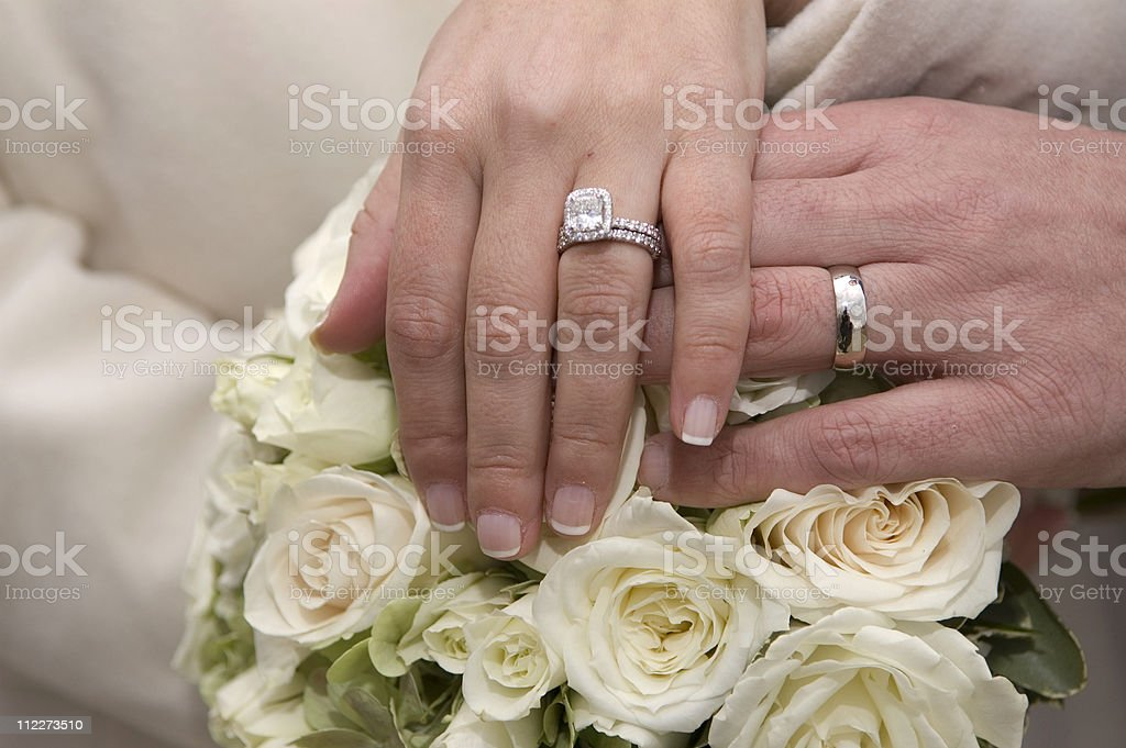 Wedding rings, Bouquet royalty-free stock photo